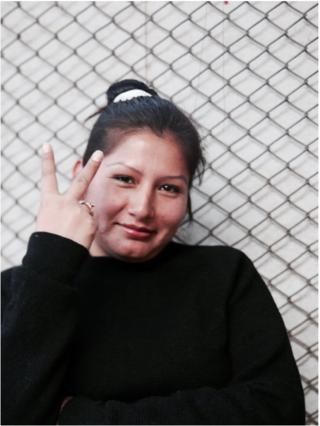 Anabel, one of Carcel employees in Cusco, have been in prison for 2 years and 2 months now. She is wearing a CARCEL sweater.